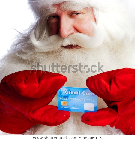 Traditional Santa Claus holding and sowing credit card while giv stock photo © HASLOO
