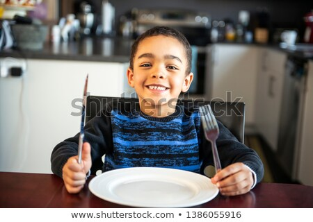Sulky girl sitting at the breakfast table Stock photo © photography33