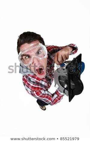 An impatient man using a circular saw Stock photo © photography33