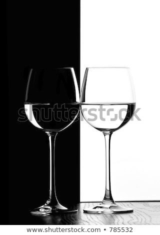 Stock photo: glasses in backlight on the black and white