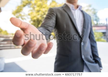 Man holding hands to give something away Stock photo © jacojvr