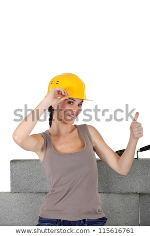 Female stonemason giving the thumb's up Stock photo © photography33