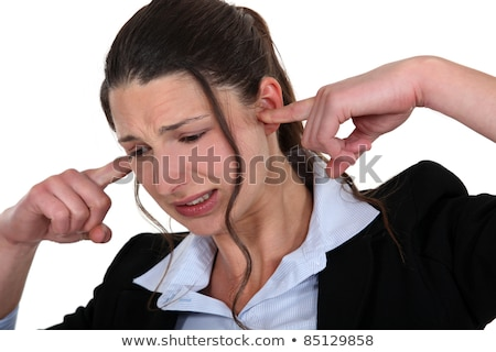 Woman being driven crazy by loud noise Stock photo © photography33
