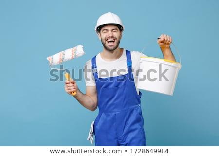 Decorator holding paint brush Stock photo © photography33
