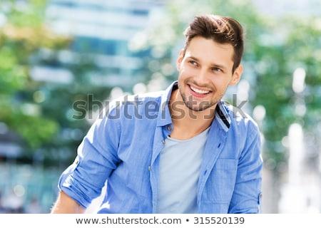 Stock fotó: Férfi · mosoly · nagyszerű · néz · fiatalember · szép
