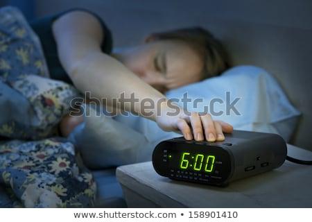 fiatal · nő · alszik · fehér · ágy · ébresztőóra · nő - stock fotó © CandyboxPhoto