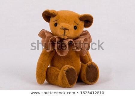lovely redhead with teddy bear stock photo © dolgachov