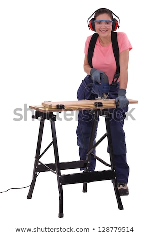 female capenter cutting plank with electric saw stock photo © photography33
