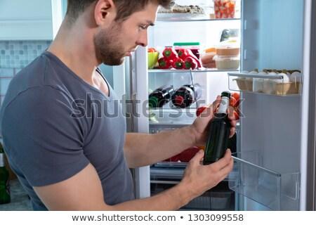 Férfi üveg sör férfiak ital csepp Stock fotó © photography33