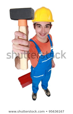 Young mason displaying lump hammer Stock photo © photography33