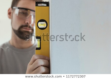 Man with a spirit level Stock photo © photography33