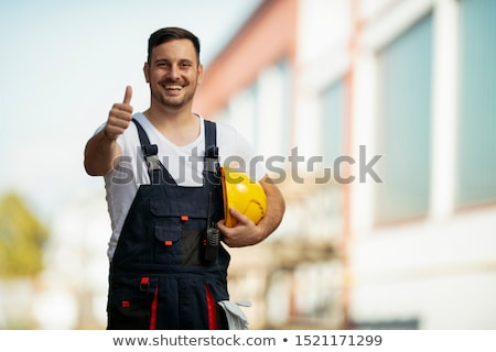 Young handyman thumbs-up gesture Stock photo © photography33