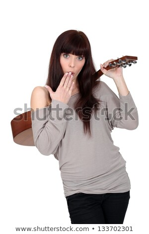 Woman stood holding acoustic guitar stock photo © photography33