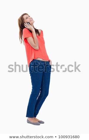 Widok z boku shot kobieta mówić telefonu komórkowego patrząc Zdjęcia stock © wavebreak_media