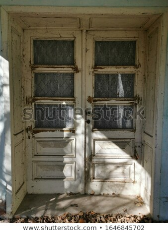 Adobe building with old door and bench Stock photo © emattil
