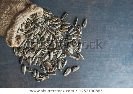 Closeup raw sunflower seeds on burlap Stock photo © deyangeorgiev