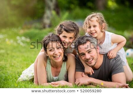 Stok fotoğraf: Aile · dört · lies · çim · sevmek · çocuk