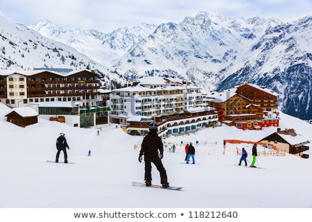 hotels on ski resort and snowboarder on slope stock photo © bsani