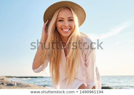 mooie · blond · meisje · rode · lippen · nagels · eten - stockfoto © kalozzolak