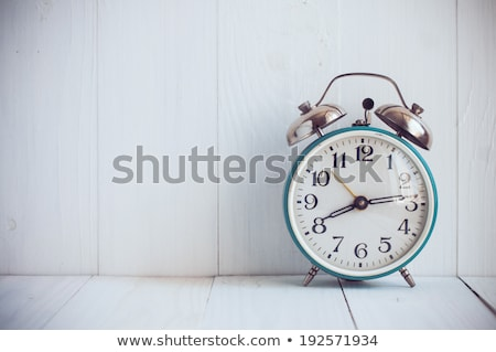 Retro alarm clock on wooden table Stock photo © stevanovicigor