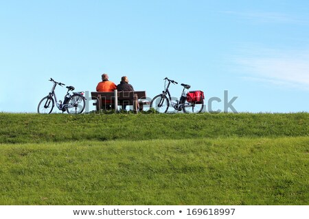 Pair with bikes made a rest on the dam stock photo © richardjary