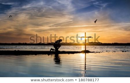 Lago preghiera cross uomo accanto sole Foto d'archivio © rghenry