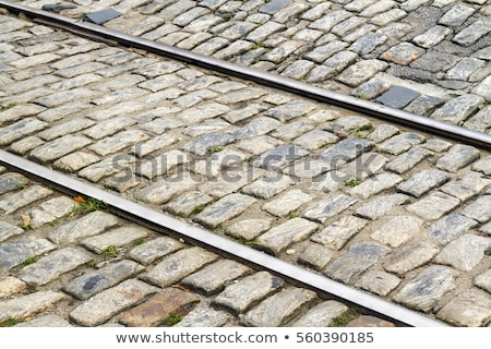 Stock photo: rails of streetcar in old cobble stone street