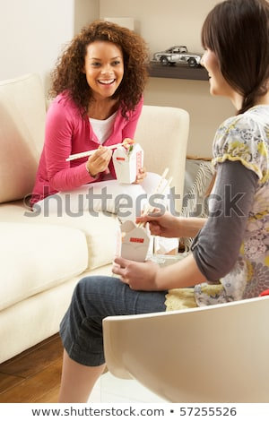 Group Of  Friends Enjoying Chinese Takeaway Meal At Home stock photo © monkey_business