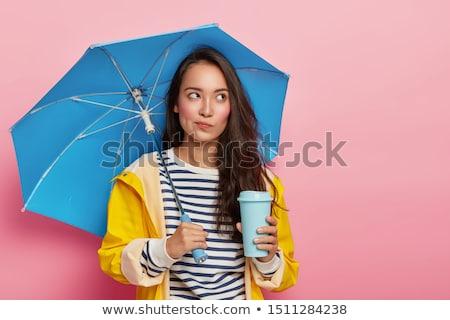 Jonge vrouw Geel regenjas studio vrouw Stockfoto © monkey_business