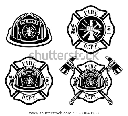 Firefighter with helmet and axe in a flame Stock photo © Nejron