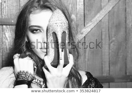 black high heel female shoes and glamour necklace stock photo © elisanth
