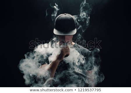 Handsome man vaping Stock photo © HASLOO