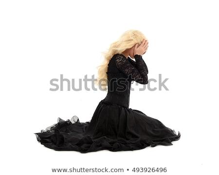 Beautiful woman sitting wearing a corset Stock photo © sumners