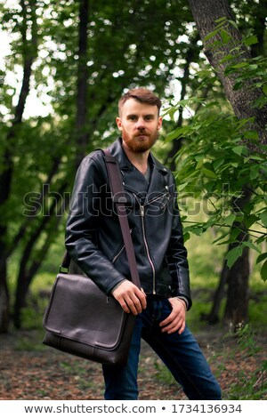 man leaning on a tree with his hands in pockets. Stock photo © feedough