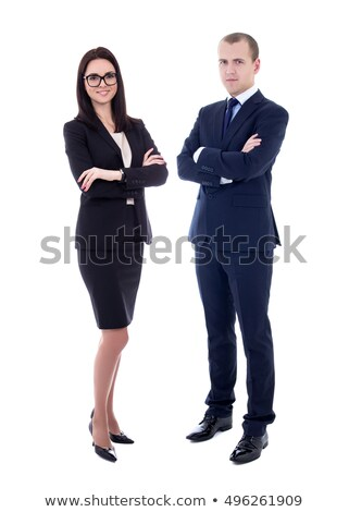 Full-length portrait of a handsome businessman in glasses on gray background Stock photo © deandrobot