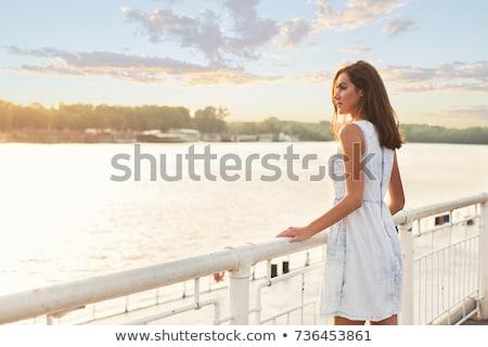 beautyful woman sitting on riverside Stock photo © PetrMalyshev
