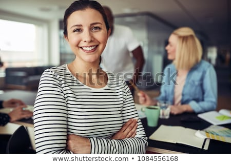 portrait of smiling businesswoman with arms crossed stock photo © andreypopov