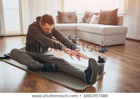 sports man stretching legs stock photo © deandrobot