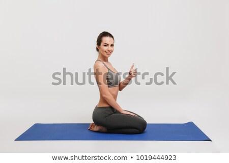 heureux · femme · souriante · séance · serviette · photos · femme - photo stock © deandrobot