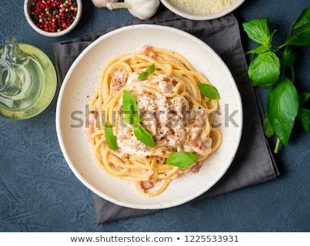 спагетти перец ветчиной сковорода Top травы Сток-фото © zoryanchik