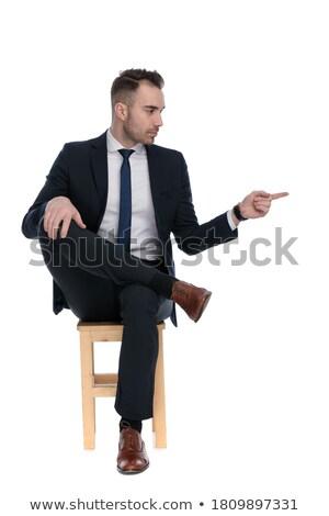красивый · мужчина · сидят · скрещенными · ногами · прикасаться · подбородок · молодые - Сток-фото © feedough