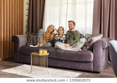 Smiling children three together in cosy room shows  stock photo © Paha_L