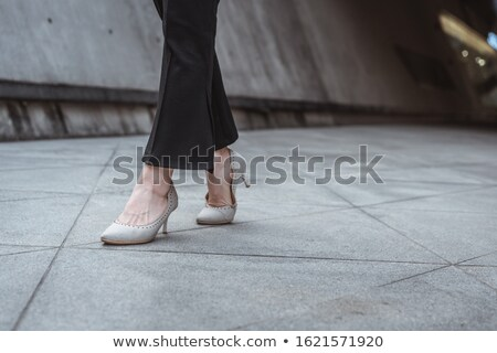 legs of young woman in pants and high heels shoes stock photo © deandrobot