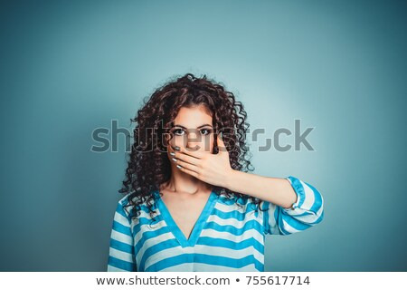 Scared shocked teenage girl covered her face with striped top  Stock photo © deandrobot