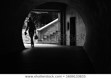 People walking through arch in Budapest. Stock photo © kyolshin