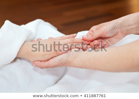 Hand massage with nourishing oils Stock photo © gsermek