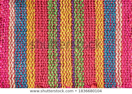 Stock photo: Close up on hand woven colorful rug at angle