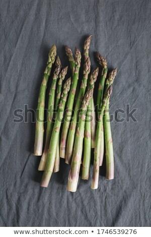 Bunch of fresh asparagus on kitchen cloth closeup Stock photo © rafalstachura