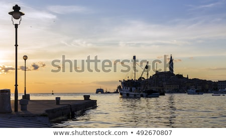 Sunset in Rovinj, hair historic city in the background. Stock photo © justinb