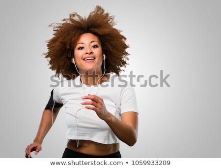 woman running with earphones and smartphone stock photo © rastudio